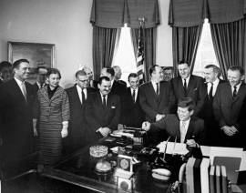 Kennedy signs Peace Corps Act